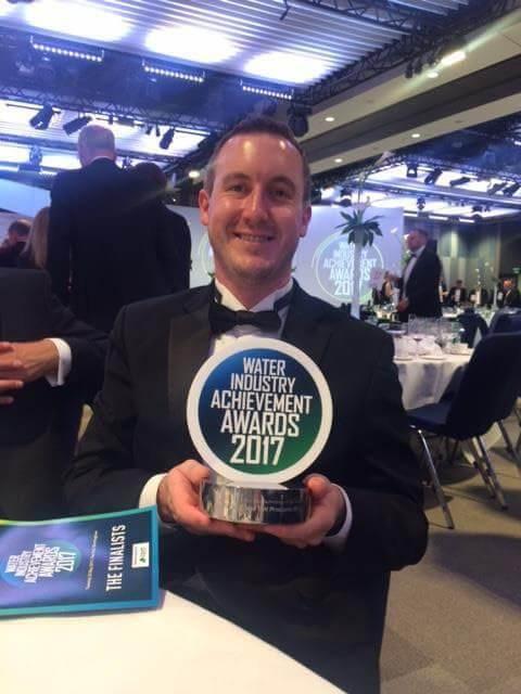 Winner holding the Water Industry Award
